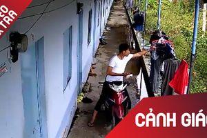 Nam thanh niên 'cẩn thận' lựa quần áo để trộm
