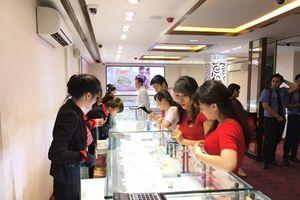 Hai thương hiệu vàng trong nước giảm giá nhẹ, thế giới tiếp tục tăng
