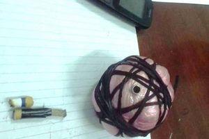 Nghệ An: Phát hiện một quả mìn sắp phát nổ dưới gầm xe ô tô