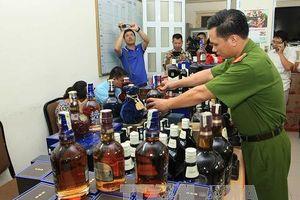 Phát hiện nhiều kho chứa hàng chục nghìn chai rượu nghi dùng tem giả
