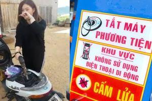 Thanh niên Đà Lạt cầm ĐTDĐ quay gái xinh đổ xăng: Dại dột hay chẳng sao?