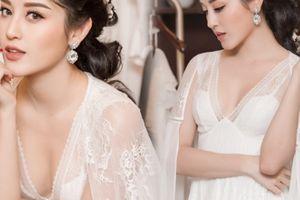 Á hậu Huyền My lấp ló ngực đầy trong làn váy trắng mỏng manh