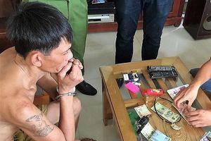 Trữ 2 khẩu súng, 'ông trùm' kinh doanh từ thuốc phiện đến ma túy đá