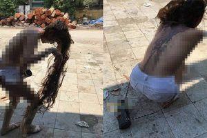 Cô gái bị lột đồ, cắt tóc, đổ mắm tôm lên người vì ghen tuông