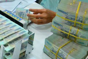 Lãi suất liên ngân hàng hạ nhiệt, lãi suất huy động vẫn cao