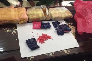 Chuẩn bị giao 18.000 viên thuốc lắc thì bị bắt trong khách sạn