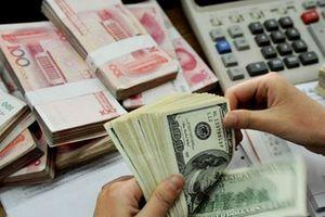 Tỷ giá trung tâm tiếp tục tăng, giao dịch USD trên thị trường tự do giảm
