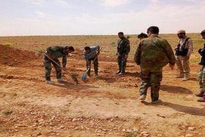 Hãi hùng mộ tập thể phụ nữ, trẻ em bị IS giết ở Hama