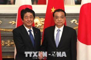 Bất đồng thương mại với Mỹ, Nhật-Trung nhất trí 'bắt tay' hợp tác kinh tế