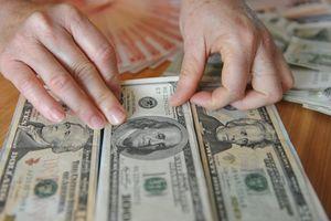 Phía sau câu chuyện đổi 100 USD phạt 90 triệu
