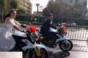 Clip: Cô dâu 'chất lừ' lái mô tô phân khối lớn gây náo loạn đường phố