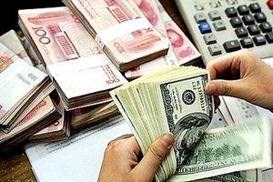 Tỷ giá trung tâm giảm, ngân hàng thương mại tăng giá mua – bán USD