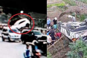 Clip: Nữ tài xế lùi bất cẩn, ô tô lao vọt xuống bờ kè nằm phơi bụng