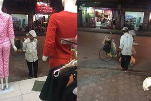 Người đàn ông lam lũ đứng tần ngần trước shop quần áo và lời hứa hẹn khiến ai cũng cảm động