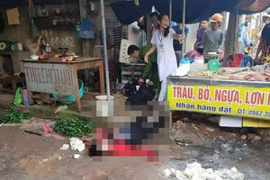 Đối tượng bắn, đâm chết thiếu phụ bán đậu giữa chợ đã tử vong