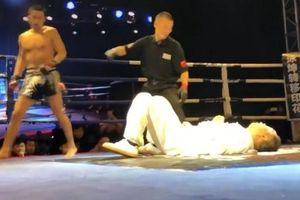 Võ sĩ kickboxing tung một đấm hạ đo ván cao thủ thái cực quyền
