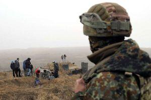 Người dân Ukraine đào hào, sẵn sàng ứng phó với một cuộc tấn công từ Nga