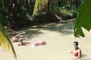 Thi thể 1 phụ nữ bị trói 2 chân dưới mương nước