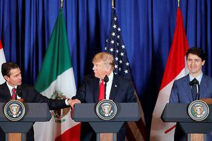 Mỹ, Canada, Mexico phá rào thương mại vào phút chót