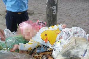 Bé trai khoảng 5 tháng tuổi bị bỏ rơi ở thùng rác trên đường Doãn Kế Thiện