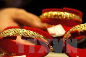 Giá vàng tăng 0,2%, giá đồng USD giảm