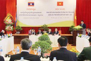 Trao đổi kinh nghiệm về công tác tôn giáo Việt Nam - Lào