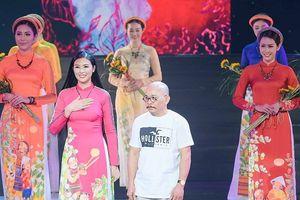 Sao Việt thích thú với loạt thiết kế áo dài của Hoa hậu Ngọc Hân
