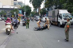 TP.HCM: 2 xe máy va chạm, cô gái đứt gần lìa chân trên đường đi làm