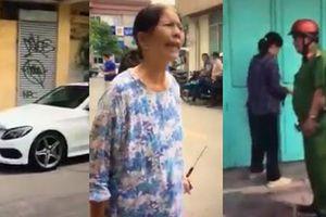 Đậu xe Mercedes giữa cửa nhà còn thách thức, cụ bà cầm búa đập nát đầu xe bạc tỷ