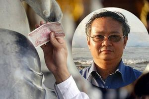 Nhét tiền vào tay Phật là lú lẫn, lợi dụng tôn giáo kiếm tiền coi chừng nghiệp báo