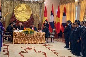 Việt Nam - Lào: Ký Hiệp định về hợp tác phát triển các công trình năng lượng điện và mỏ