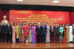 Tổng Bí thư, Chủ tịch nước Nguyễn Phú Trọng gặp cộng đồng người Việt Nam tại Lào
