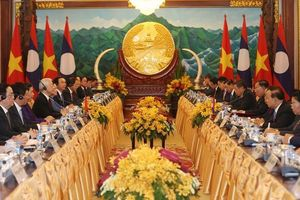 Công cuộc đổi mới của Việt Nam và Lào đang bước vào giai đoạn then chốt