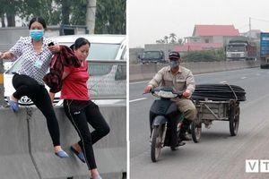 Người đi bộ tháo tấm chống chói mở lối đi, xe máy, xe đạp thi nhau phóng ngược chiều trên quốc lộ 10