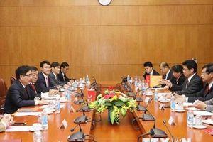 Việt-Lào chia sẻ kinh nghiệm xây dựng chính sách kinh tế-xã hội
