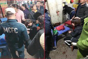 Tên cướp bịt mặt, nổ súng đe dọa tiểu thương ở chợ Long Biên, Hà Nội