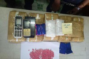 Bắt 2 kẻ vận chuyển 40.000 viên ma túy tổng hợp vào Việt Nam