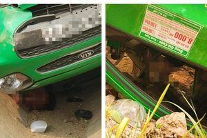 Taxi lật ngửa nằm đè lên tài xế