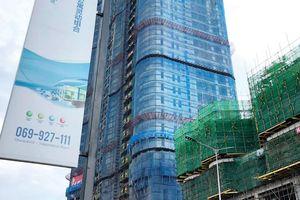 Gọng kìm với đà tăng giá nhà tại Trung Quốc