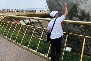 CĐM 'điên tiết' với người đàn ông vẽ bậy lên cầu Vàng Đà Nẵng
