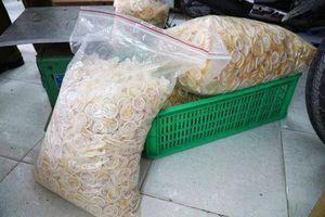 Đường dây làm bao cao su giả ở Sài Gòn