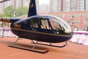 Đại gia TQ bị 'ném đá' vì đến trường con gái lớp 1 bằng trực thăng