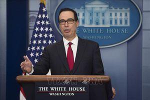 Trung Quốc giảm mua trái phiếu chính phủ Mỹ