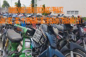 Choáng với kho hàng ngàn xe máy 'sắt vụn' không ai đến nhận của CSGT TP.HCM