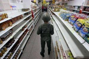 Venezuela thừa nhận kinh tế suy giảm gần 50%