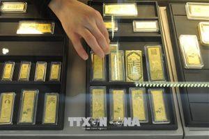 Giá vàng thế giới rời đỉnh của tuần