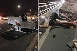 Vụ xe ô tô Mazda 2 lật ngửa trên cầu Nhật Tân: Cô gái nguy kịch, tài xế xe bồn bị đưa về trụ sở công an