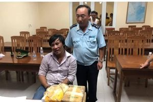 Giấu 40.000 viên ma túy tổng hợp trong 2 bình gỗ vận chuyển từ Lào về Việt Nam
