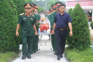 Truy điệu, an táng 12 hài cốt liệt sĩ quân tình nguyện Việt Nam hy sinh tại Lào