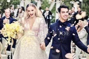 Váy cưới đính hàng chục nghìn viên pha lê của mỹ nhân 'X-Men'